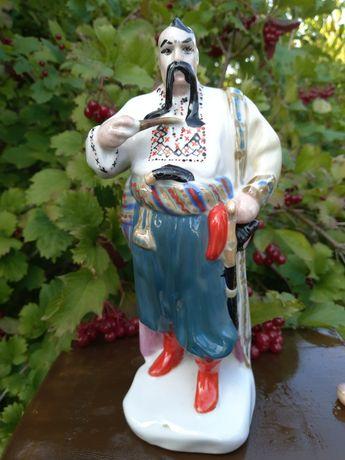 фарфоровая статуетка - козак с люлькой
