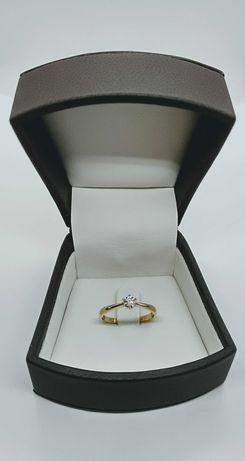 Złoty pierścionek z Brylantem 0,22ct SI1/H