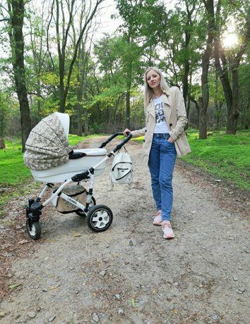 Продам красивую  детскую коляску