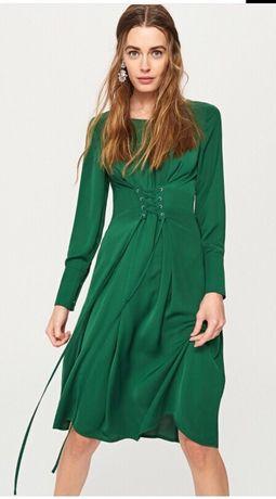 Sukienka midi do połowy łydki zielona z wiązaniem