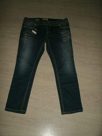 Nowe spodnie dżinsowe rurki z przetarciami roz.46