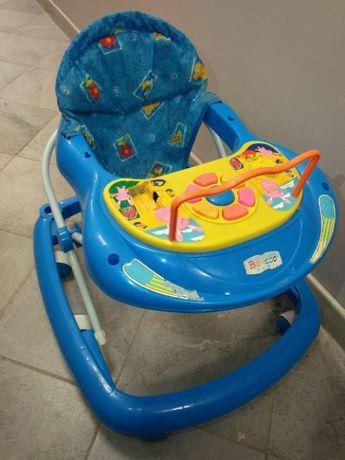 Krzesełko jeździk dla dzieci na kółkach z panelem interaktywne