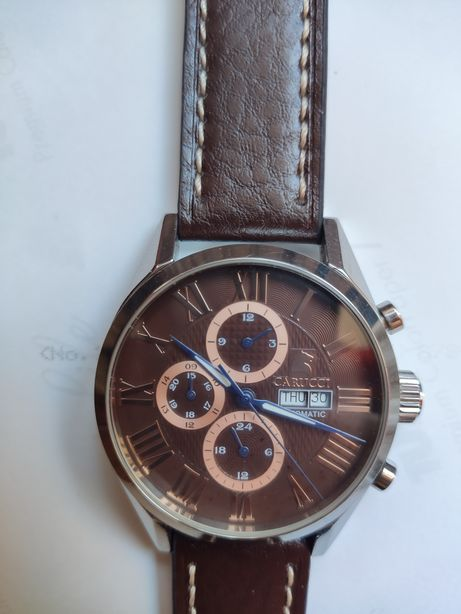 Часы Carucci