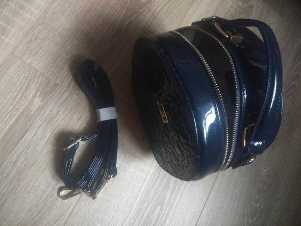 Okrągła nowa torebka Jennifer Lopez- j.lo