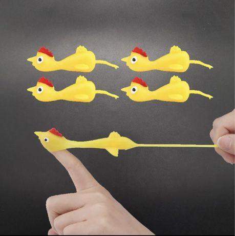 детская игрушка курица стрелялка