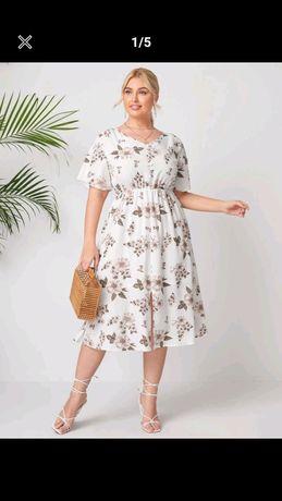 Sukienka 50-52 w kwiaty