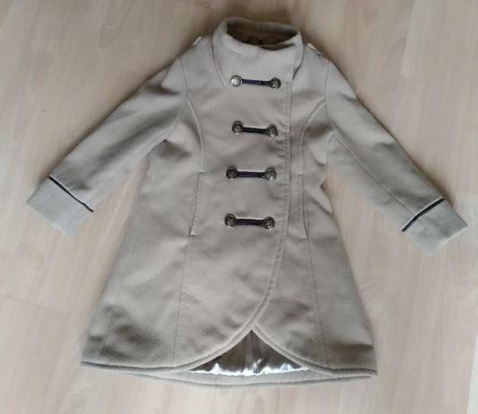 Dziewczęcy, beżowy płaszczyk ze stójką. 110-116 cm