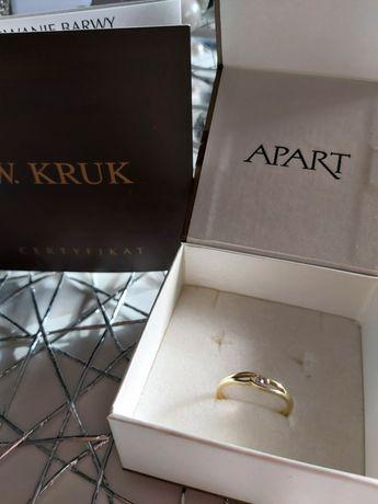 Złoty pierścionek 585 z brylantem roz 14