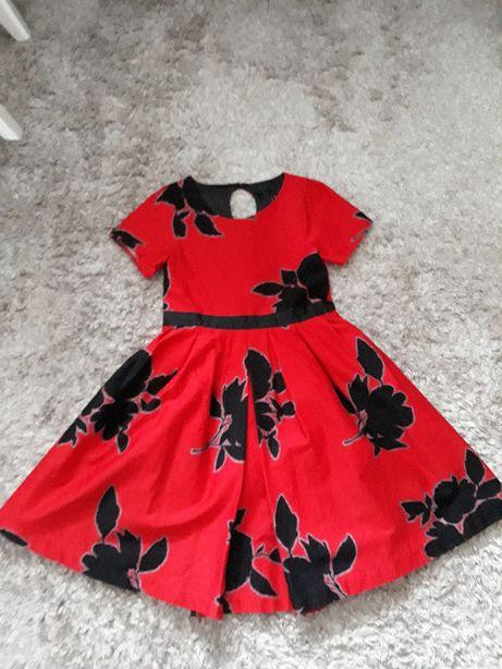 Rozm. 134 - elegancka sukienka na krótki rękaw kwiaty