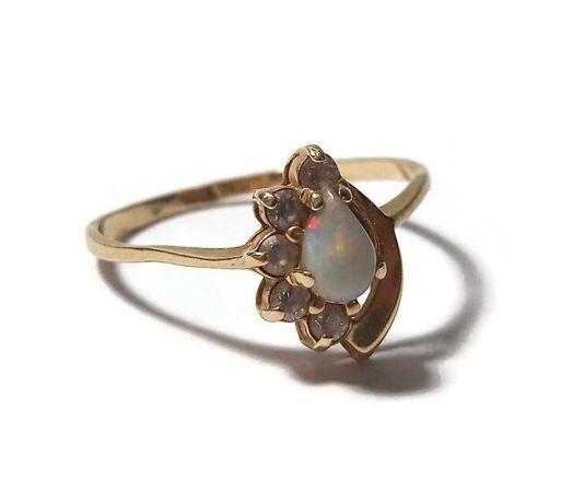 Złoty pierścionek 585/1,68G