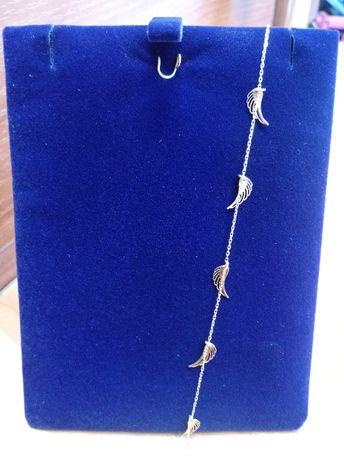 Złota bransoletka ze skrzydełkami pr. 585