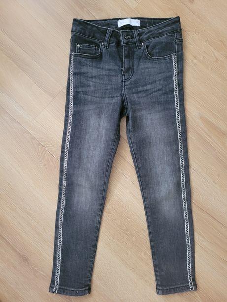 Czarne spodnie dżinsy ZARA z lampasami z cyrkoni 122 na 7 lat