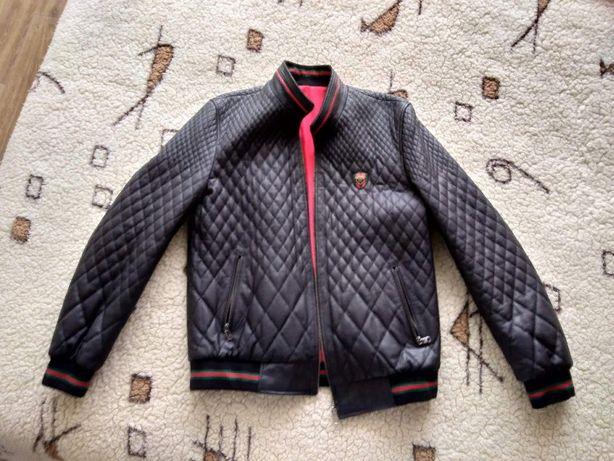 продам кожаную новую двухстороннюю мужскую курточку
