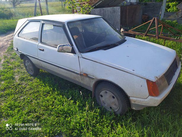 Продам автомобіль ЗАЗ Таврія і мото трактор(з обладнанням)