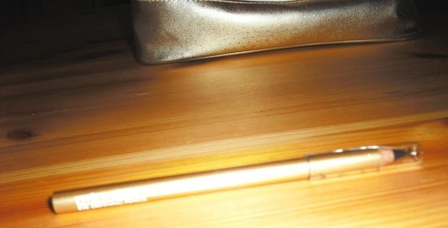 Kosmetyczka złota E. Lauder z ołówkiem do powiek/brwi