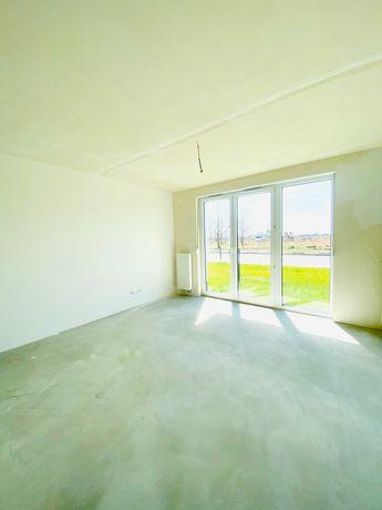 Nowe 2 pok. mieszkanie z ogródkiem, garażem i komórką.