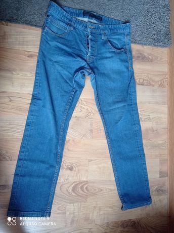 Spodnie jeans  Reserved w34 L32