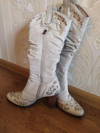 Зимнии кожаные сапоги.