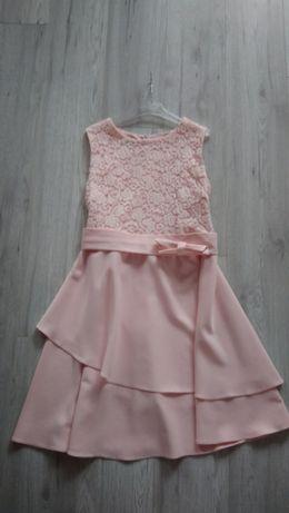 Pudrowo różowa rozkloszowana sukienka z kokardą w pasie 44