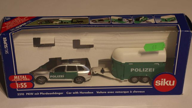 Wóz policyjny Porsche Cayenne z przyczepą dla koni SIKU 2310 - rarytas