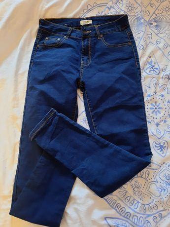 Spodnie carry r s jak nowe