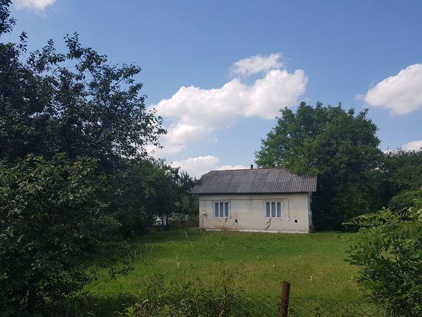 Будинок з землею під забудову