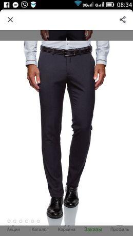 Продам брюки на подростка темно-синего цвета 44размера