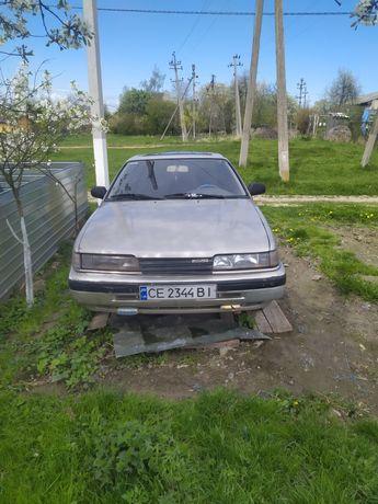 Машина Мазда 626