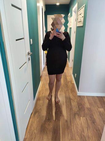 Czarna sukienka 42 może być ciążowa