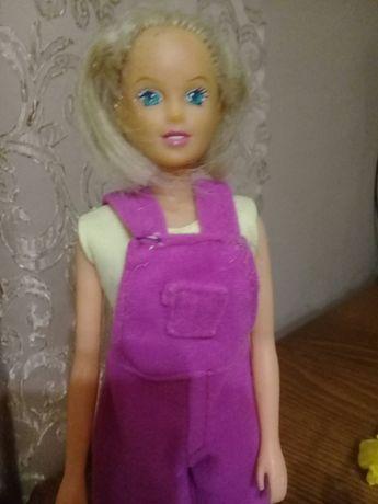 Лялька з одягом і рюкзачком