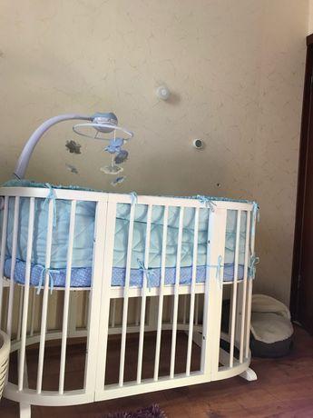 Продам детскую кроватку Ovalbed 8 в 1
