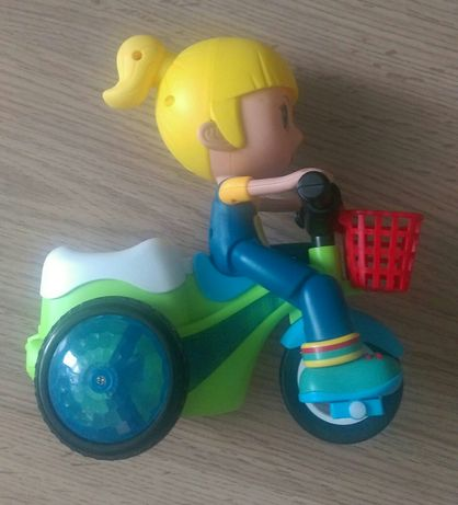 "Игрушка б/у на батарейках ""девочка на велосипеде"""