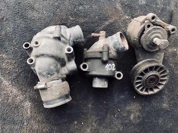 Корпуси термостатів м102 мотор натяжний механіз м102 2.3.W123-124-115