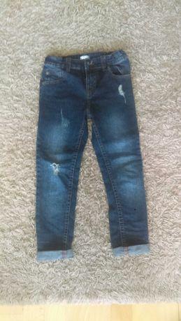 Spodnie jeansowe z przetarciami dla chłopca jak nowe