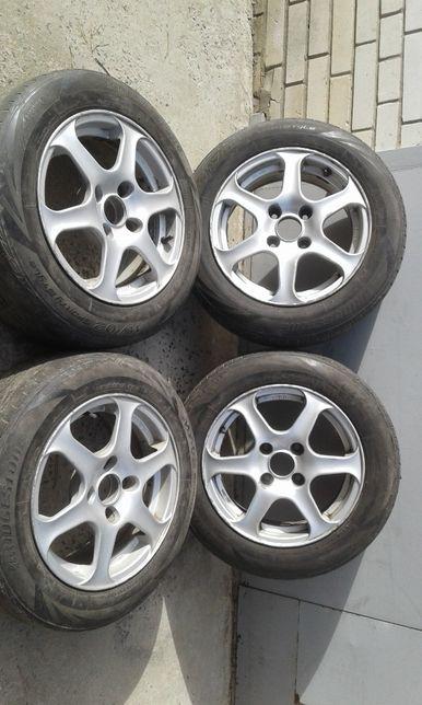 Продам легкосплавные диски rial с резиной Bridgestone 195/60R15