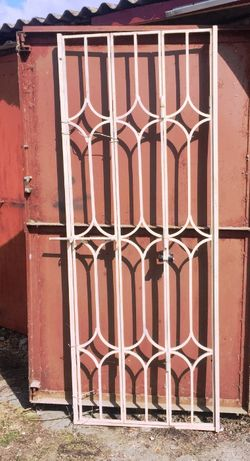 Решётка-гармошка на двери