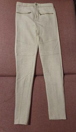 Kremowe spodnie Bershka