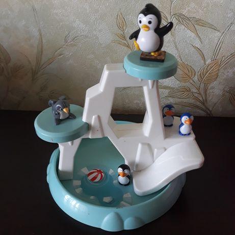 Пингвины в бассейне.