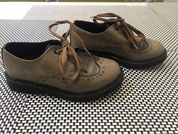 Дитячі шкіряне  взуття clarys
