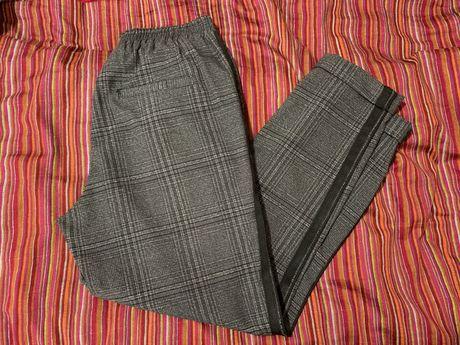 Spodnie damskie w kratę z lampasem XS/S