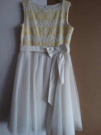 Sprzedam sukienkę wizytową dla dziewczynki w rozmiarze 152 firmy SLY.