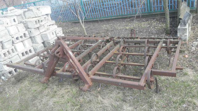 Культиватор тракторный пружинный