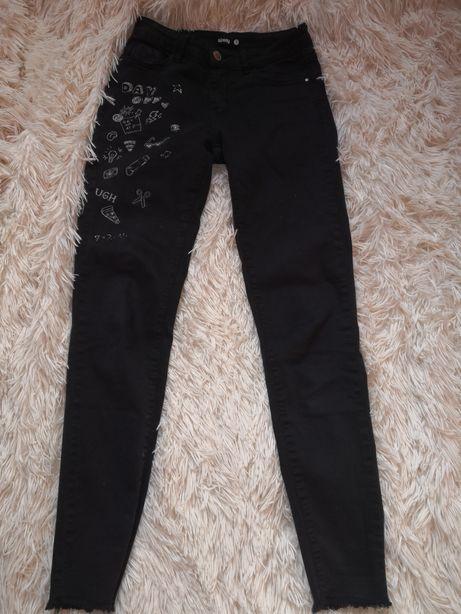 Spodnie z nadrukami sinsay