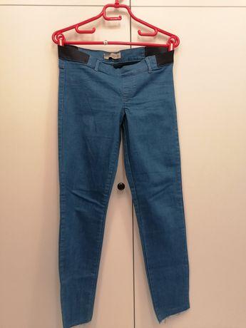 Spodnie materiałowo - jeansowe.