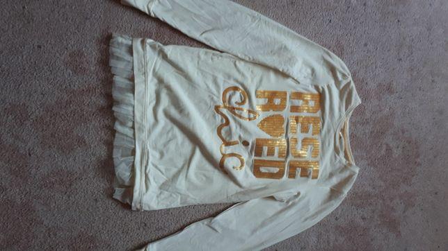 Biała dziewczęca bluzka z Reserved.