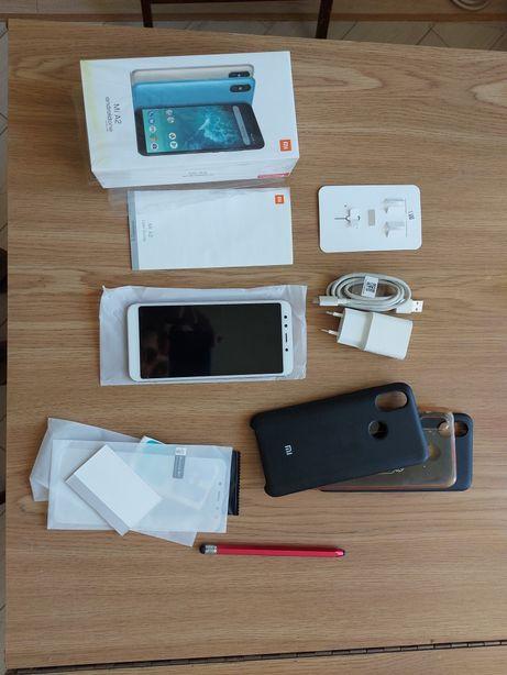 Телефон Xiaomi mi a2 64 с чехлами, доп стеклом, стилусом и наушниками