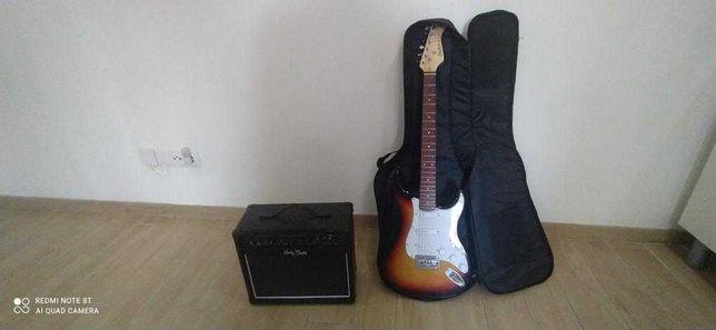 Guitarra com amplificador e mala de transporte