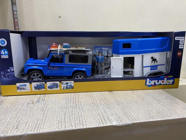 Машинка Bruder Полицейский джип Land Rover с прицепом