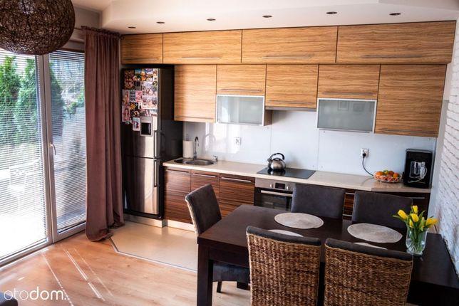 Dwupoziomowe mieszkanie z ogródkiem