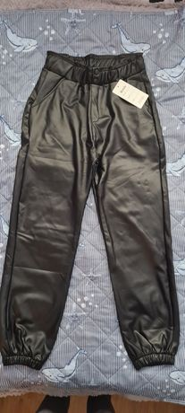 Nowe ocieplane spodnie z ekoskóry